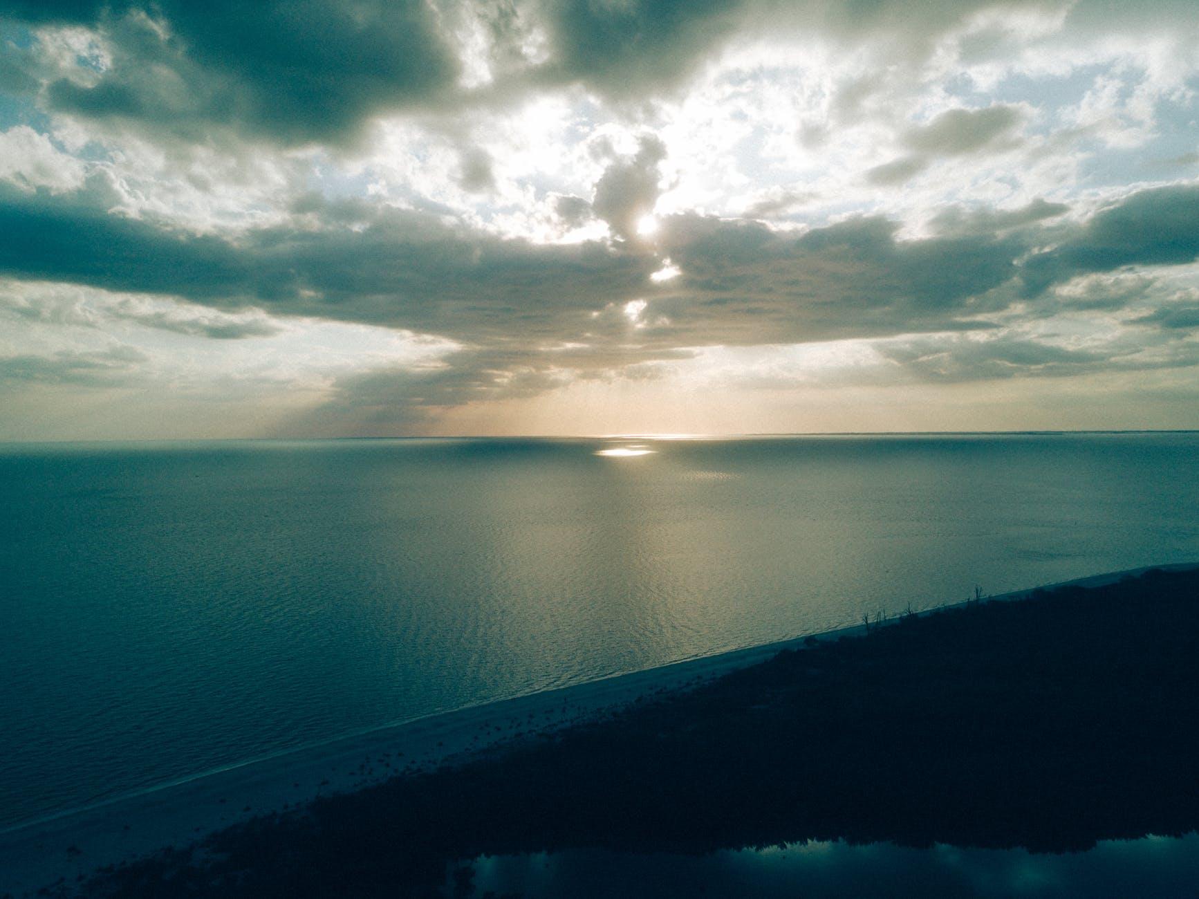 beach bird s eye view clouds dawn